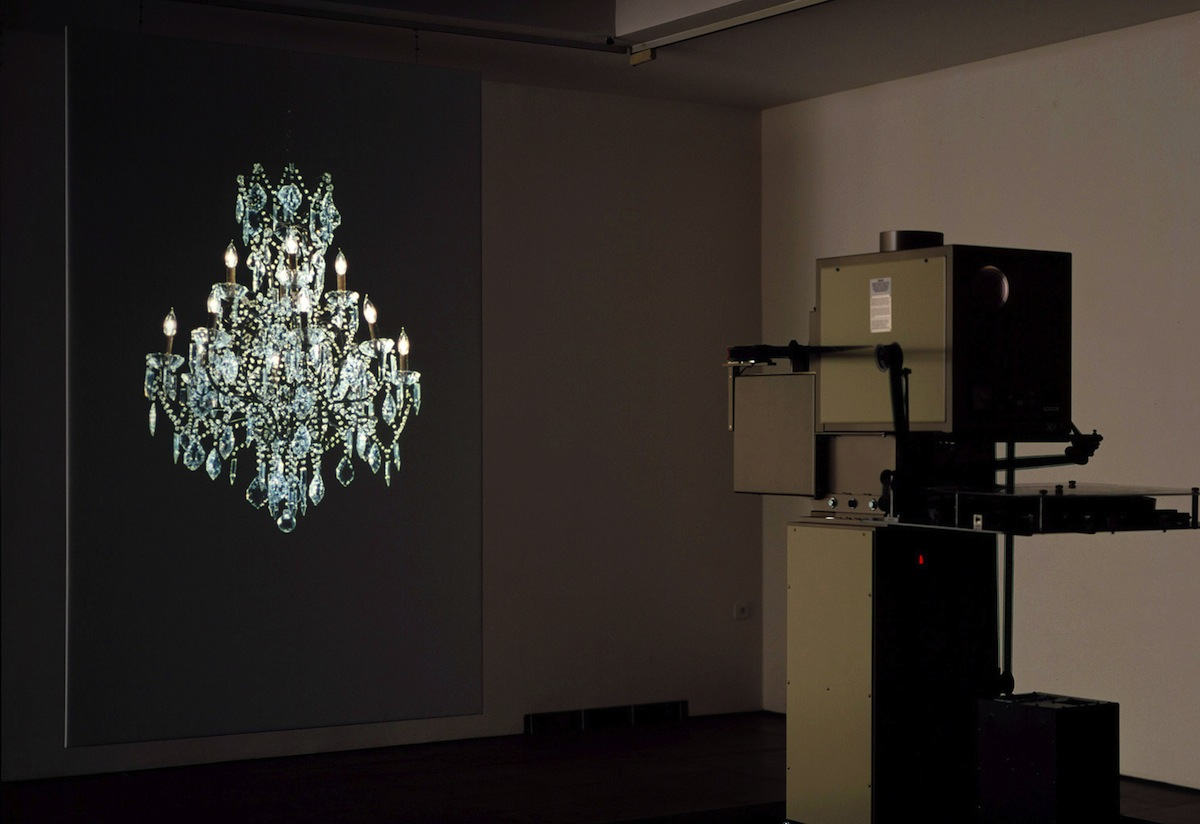 Rodney Graham, Torqued Chandelier Release, 2005, 35mm silent colour film (5min), purpose built projector, screen. Screen: 305 (h) x 183 (w) cm. Courtesy of the artist and the Lisson Gallery.