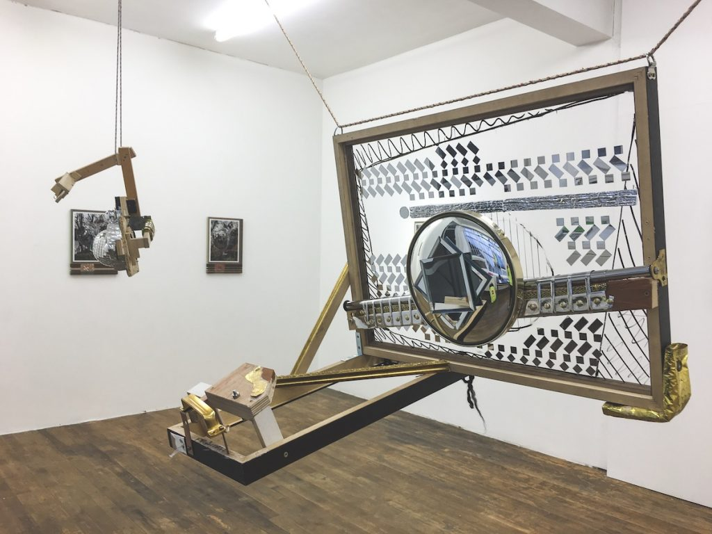 David Lunney, Chrome Dreams, 2018, Framing, ArtGlass, various mirrors (novelty convex mirror, vanity mirrors, self-adhesive acrylic mirrors), chrome pole, reflective ribbon, camera bolt, fixings, wood, 52cm x 55cm x 69cm, Photo courtesy the writer.
